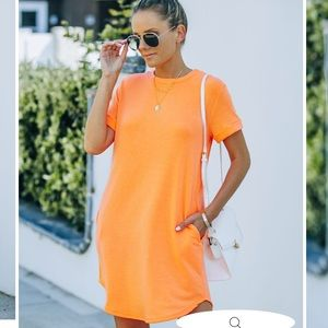 Nial Pocketed Knit T-Shirt Dress in Neon Orange